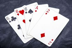 Five playing card`s stud hand three of a kind six and ace a two fun Royalty Free Stock Image