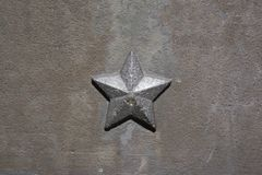Five-pointed star of communism and socialism. Detail of historical monument and memorial from period of socialism and communism. Surface with structure and stock photos