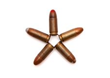 Five-pointed star made of cartridges. Five-pointed star made of 9mm Parabellum cartridges isolated Stock Photo