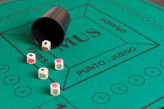 Five poker dices of ases, kings and beaker on the green casino f stock photos
