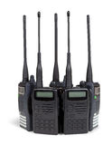 Five portable radio sets. Isolated on white. Stock Photo