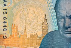Five Pound Note with Churchill and Parliament. Closeup detail of UK five pound note showing image the Houses of Parliament and Winston Churchill stock photo