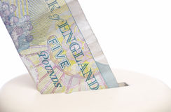Five pound note & piggy bank. Stock Image