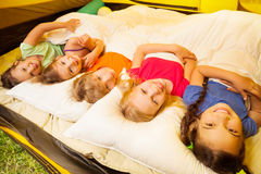 Five pretty kids lay covered with blanket Royalty Free Stock Photos