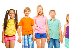 Five pretty kids in a row on white Stock Photo