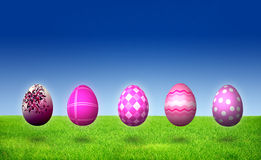 Five Purple Easter Egg Hunt. On grass Stock Image