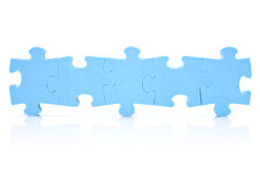 Five puzzle pieces connected in a row Royalty Free Stock Images