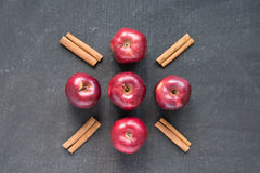 Five red apples and cinnamon Royalty Free Stock Image