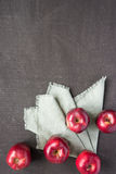 Five red apples on a painted board Royalty Free Stock Photos