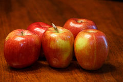 Five Red Apples on Wood Table Stock Photos