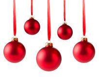 Five red christmas balls hanging Royalty Free Stock Photos