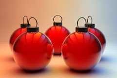 Five red Christmas baubles Stock Photos