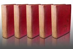 Five red cover books on reflected floor Royalty Free Stock Photography