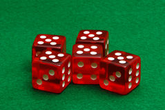 Five Red Dice. Sit on green felt Royalty Free Stock Photography