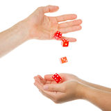 Five red dice being thrown from a hand Stock Photos