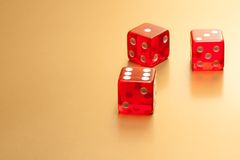Five red dice on golden background Royalty Free Stock Photos