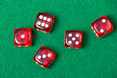 Five red dices on green table Stock Photo