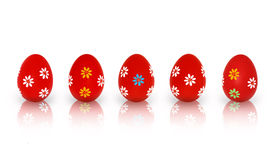 Five Red Easter Eggs. Five different red Easter eggs with floral patterns standing in a line  on a white background Stock Image