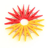 Five red and five yellow pegs situated around Stock Photos