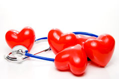 Five red 'hearts' and stethoscope Stock Images