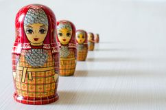 Five red matryoshka. Long shadows stock photo