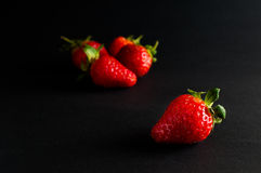 Five red strawberries Stock Photos