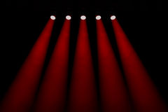 Five red symmetrical spotlights Royalty Free Stock Images