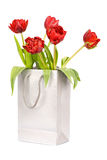 Five red tulips in silver paper bag Royalty Free Stock Photos