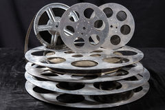 Five reel of film in retro. Five Movie reel on a black background Royalty Free Stock Image