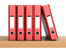 Five ring binders. 3d illustrations of the red ring binders in row on the shelf Royalty Free Stock Image