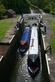 Five rise locks. The boat in 5 rise locks on leeds liverpool canal Royalty Free Stock Image