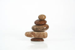 Five rocks. Balancing on a white background Royalty Free Stock Images