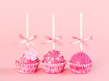 Five romantic pop cake with pink frosting on pink background. Stock Images