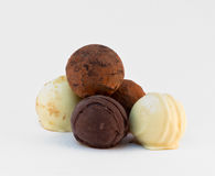 Five round chocolate sweets. On gray  background Royalty Free Stock Photography