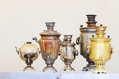Five Russian samovars of different shapes and sizes Stock Photo