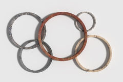 Five rusty Olympic circles on white background Royalty Free Stock Photo