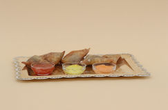 Five samosas with sauce on a silver platter Royalty Free Stock Image