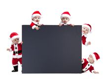Five Santa Claus baby hold black advertisment banner blank Royalty Free Stock Photography