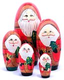 The Five Santas. Five wooden painted Christmas holiday decorative nesting toy doll figurines Royalty Free Stock Photography