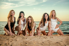 Five sexy ladies on the beach Royalty Free Stock Photos