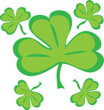 Five shamrocks. Five stylized green shamrock leaves Stock Image