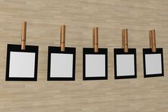 Five sheet of a paper hanging on a cord. Royalty Free Stock Image