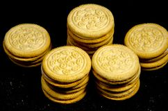Five short stack of sweet round cookie`s. A cookie is a baked or cooked food that is small, flat and sweet. It usually contains flour, sugar and some type of oil Royalty Free Stock Photo