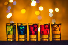 Five shots glasses full of assorted beverages and Royalty Free Stock Image