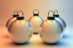 Five silver Christmas baubles Royalty Free Stock Photography