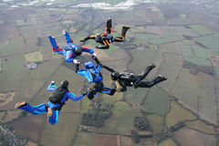 Five skydivers. Doing formations high up in the air Royalty Free Stock Image