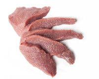 Five slices of raw meat viewed from top. Five slices of raw meat on the white background viewed from top Stock Image