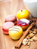 Five small appetizing cakes of a kariyets and other spices lie on a wooden tray near a white mug Stock Images