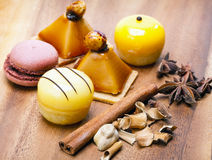 Five small appetizing cakes of a kariyets and other spices lie on a wooden tray.Still-life in a sunny day Royalty Free Stock Images