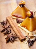 Small appetizing cakes of a kariyets and other spices lie on a wooden tray.Still-life Royalty Free Stock Photos